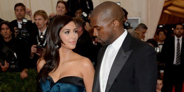 "Kim Kardashian, left, and Kanye West attend The Metropolitan Museum of Art's Costume Institute benefit gala celebrating ""Char"