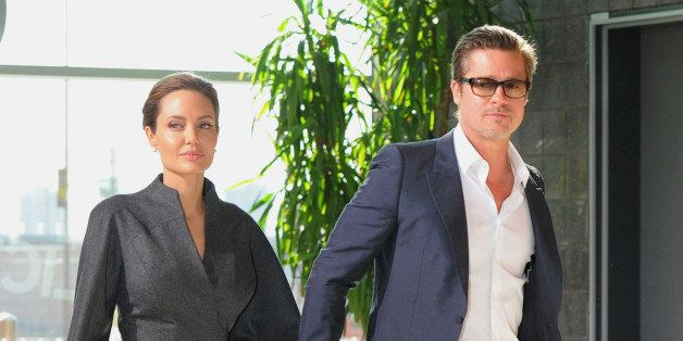 LONDON, ENGLAND - JUNE 13:  UN Special Envoy and actress Angelina Jolie and Actor Brad Pitt attend the Global Summit to End S
