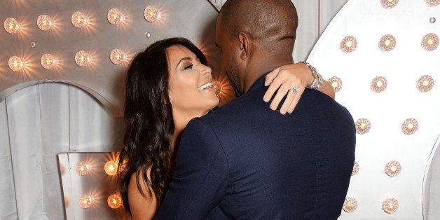 LONDON, ENGLAND - SEPTEMBER 02:  Kim Kardashian (L) and Kanye West attend the GQ Men Of The Year awards in association with H