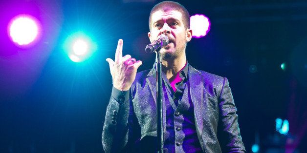 LONDON, UNITED KINGDOM - JULY 06: Robin Thicke performs on stage at Wireless Festival at Finsbury Park on July 6, 2014 in Lon