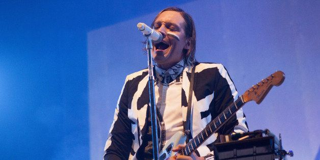 CHICAGO, IL - AUGUST 26:  Win Butler of Arcade Fire performs at United Center on August 26, 2014 in Chicago, Illinois.  (Phot