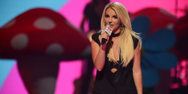 Britney Spears introduces Miley Cyrus at IHeartRadio Music Festival, day 2, Saturday, Sept. 21, 2013 in Las Vegas, NV. (Photo