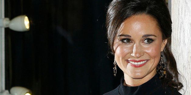 Pippa Middleton, sister to the Duchess of Cambridge, formerly known as Kate Middleton, poses for the media as she arrives at