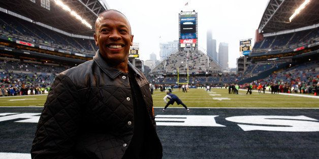 SEATTLE, WA - JANUARY 19:  Musician Dr. Dre on the field before the Seattle Seahawks take on the San Francisco 49ers at Centu