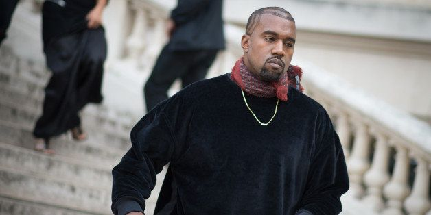 PARIS, FRANCE - SEPTEMBER 24:  Kanye West Dries van Noten show in front of the Rochas show in the streets of Paris during the
