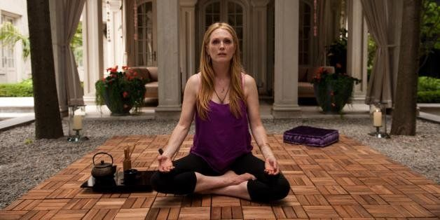 "This image released by Cannes Film Festival shows Julianne Moore in a scene from ""Maps to the Stars."" (AP Photo/Cannes Film F"