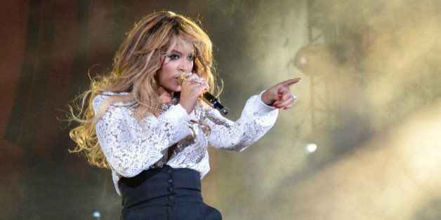 NEW YORK, NY - SEPTEMBER 27:  Beyonce performs onstage with Jay-Z at the 2014 Global Citizen Festival to end extreme poverty