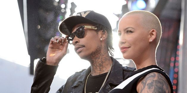 """FILE - In this May 21, 2013 file photo, rapper Wiz Khalifa, left, and Amber Rose arrive at the LA Premiere of the """"Fast &"""