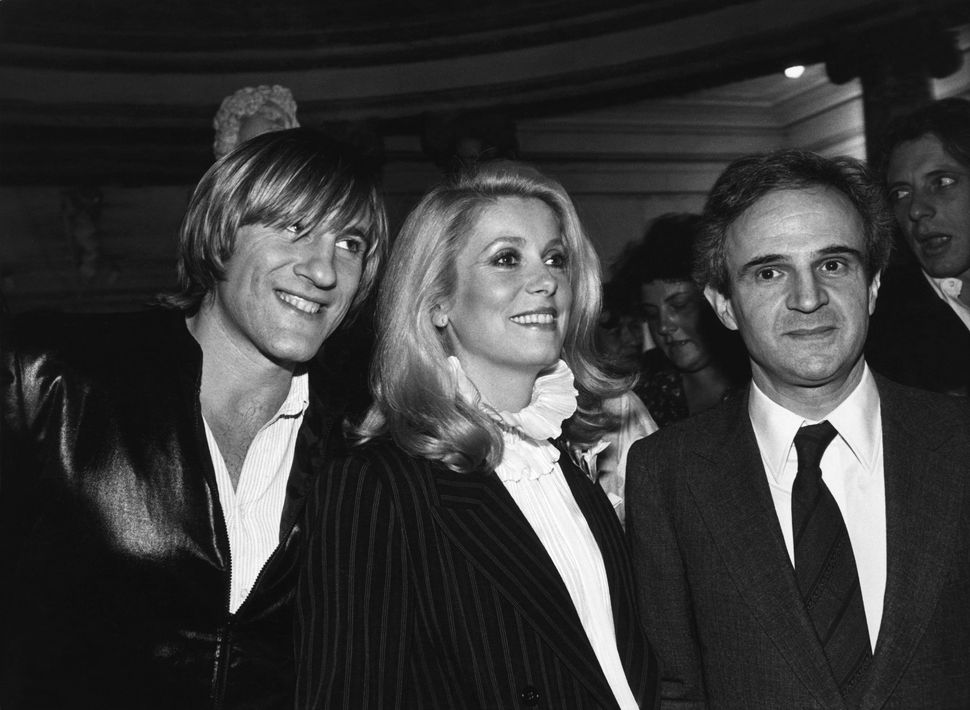 The actors Gerard DEPARDIEU and Catherine DENEUVE and the film-maker Francois TRUFFAUT attend the premiere of their film LE D