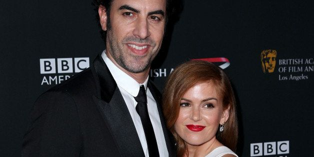Sacha Baron Cohen, left, and Isla Fisher arrive at the 2013 BAFTA Los Angeles Britannia Awards at the Beverly Hilton Hotel on