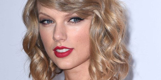 LAS VEGAS, NV - SEPTEMBER 19:  Taylor Swift poses at the 2014 iHeartRadio Music Festival - Night 1 - Press Room at MGM Grand