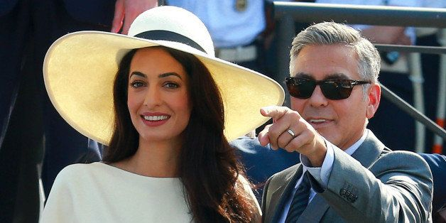 VENICE, ITALY - SEPTEMBER 29:  George Clooney and Amal Alamuddin sighting during their civil wedding at Canal Grande on Septe
