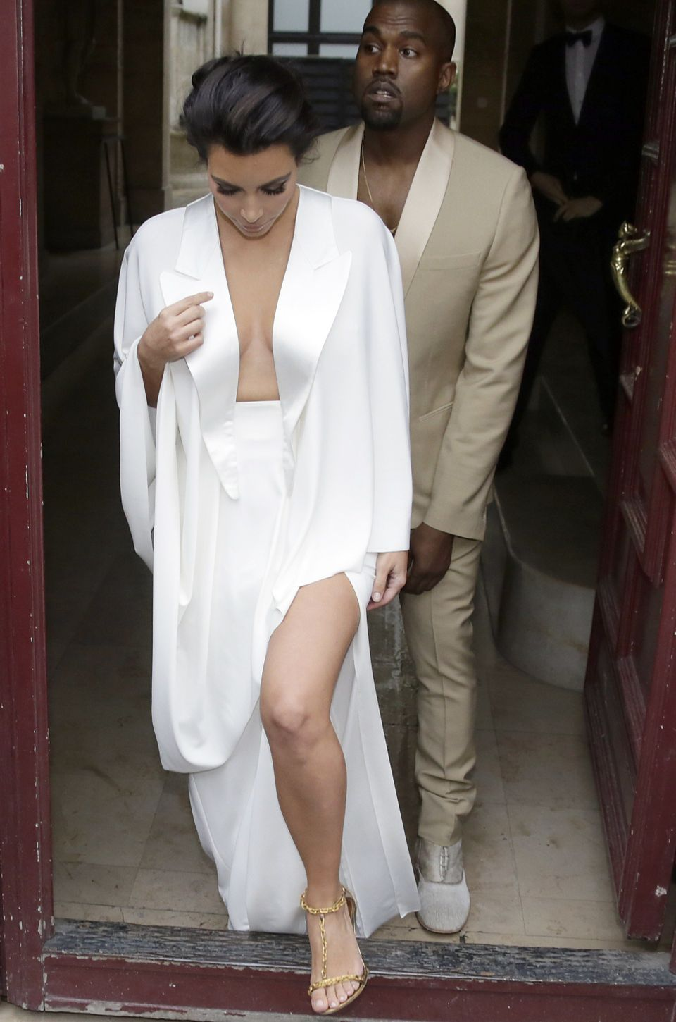 Kim sports white (with long lapels) while Kanye goes for a tan look the day before their wedding.