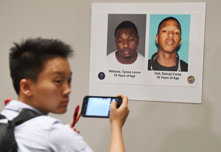 Two of the suspects' pictures were displayed during an LAPD press conference on Tuesday to announce the arrest of four suspec