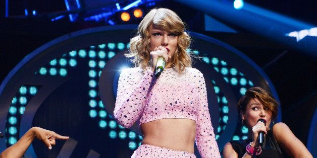 LAS VEGAS, NV - SEPTEMBER 19:  Singer Taylor Swift performs onstage during the 2014 iHeartRadio Music Festival at the MGM Gra