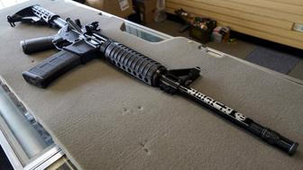 A new Ruger AR-15 rifle is seen for sale at the Pony Express Firearms shop in Parker, Colorado December 7, 2015. Many Americans are stocking up on weapons after the country's worst mass shooting in three years. Gun retailers are reporting surging sales, with customers saying they want to keep handguns and rifles at hand for self-defense in the event of another attack. REUTERS/Rick Wilking