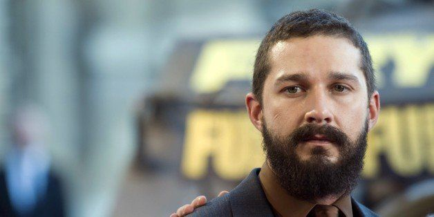 US actor Shia LaBeouf poses during a photocall for the film 'Fury', on October 18, 2014 in Paris. AFP PHOTO / MARTIN BUREAU