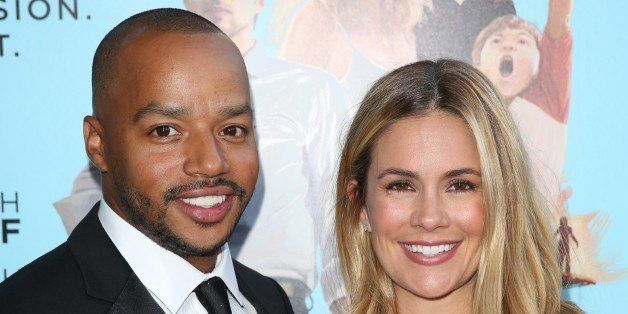 "Donald Faison, left, and CaCee Cobb arrive at the Los Angeles premiere of ""Wish I Was Here"" at the Director"