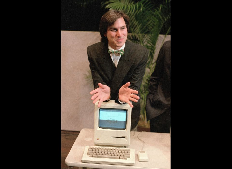 """In this Jan. 24, 1984, file photo, Steve Jobs, chairman of the board of Apple Computer, leans on the new """"Macintosh"""" personal"""