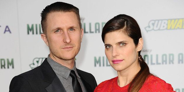 HOLLYWOOD, CA - MAY 06:  Actress Lake Bell (R) and husband Scott Campbell attend the premiere of 'Million Dollar Arm' at the