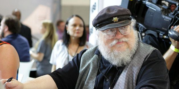 SAN DIEGO, CA - JULY 25:  Writer George R.R. Martin of 'Game of Thrones' signs autographs during the 2014 Comic-Con Internati