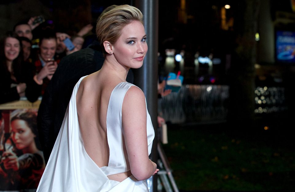 US actress Jennifer Lawrence poses for pictures on the red carpet upon arrival for the world premier of the film 'The Hunger