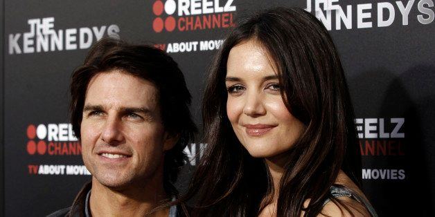 "Cast member Katie Holmes, right, and Tom Cruise arrive at the premiere of ""The Kennedys"" at The Academy of Motion Pictures Ar"