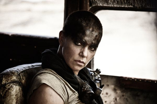 """To play Imperator Furiosa in the upcoming """"Mad Mad: Fury Road,"""" Theron shaved her head and also donned a mechanical arm loade"""