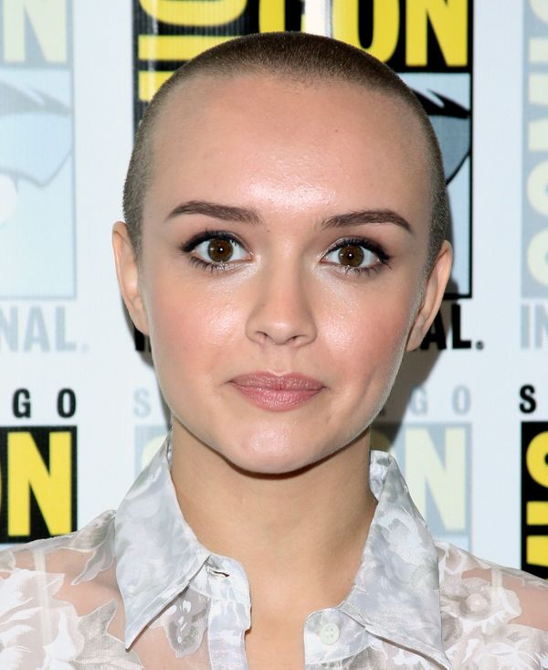 """You likely recognize Olivia Cookie from A&E's """"Bates Motel,"""" but the 20-year-old actress recently shaved her head for the ada"""