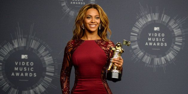 Beyonce poses with her Video Vanguard Award in the press room at the MTV Video Music Awards at The Forum on Sunday, Aug. 24,