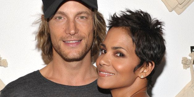 WEST HOLLYWOOD, CA - AUGUST 06:  Actress Halle Berry (R) and Gabriel Aubry attend the launch event for Gap's 1969 Jean Shop o
