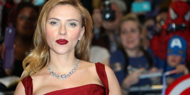 U.S. actress Scarlett Johansson poses for photographers as she arrives at the UK premiere of the movie Captain America: The W