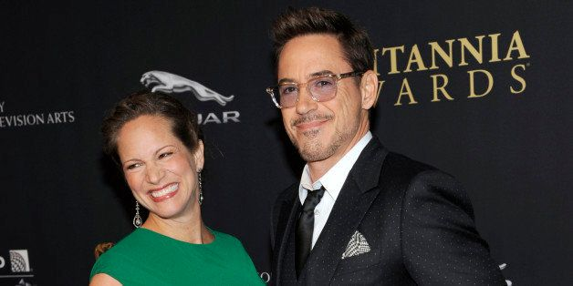 Susan Downey, left, and Robert Downey Jr. arrive at the BAFTA Los Angeles Britannia Awards at the Beverly Hilton Hotel on Thu