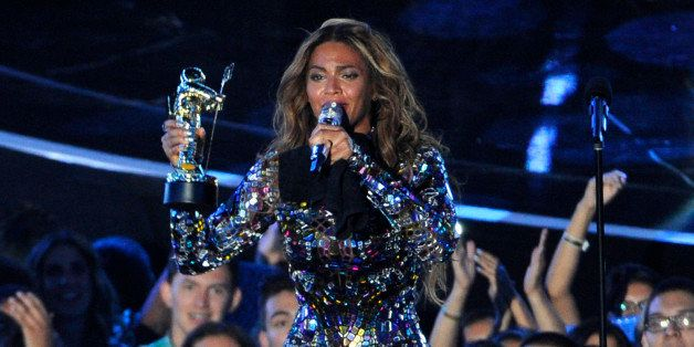 Beyonce accepts the Video Vanguard Award on stage at the MTV Video Music Awards at The Forum on Sunday, Aug. 24, 2014, in Ing