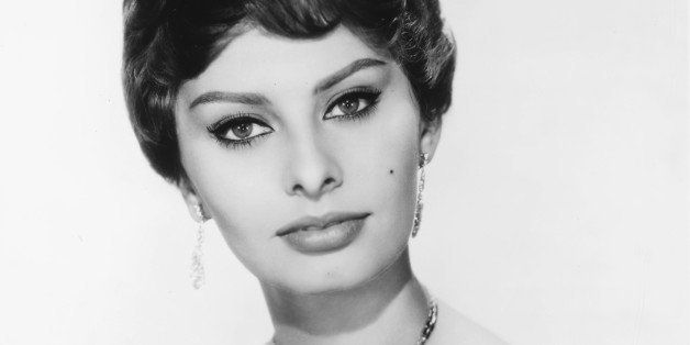 Headshot of Sophia Loren, Italian actress, looking glamorous, wearing a shoulderless dress and a diamond necklace and diamond