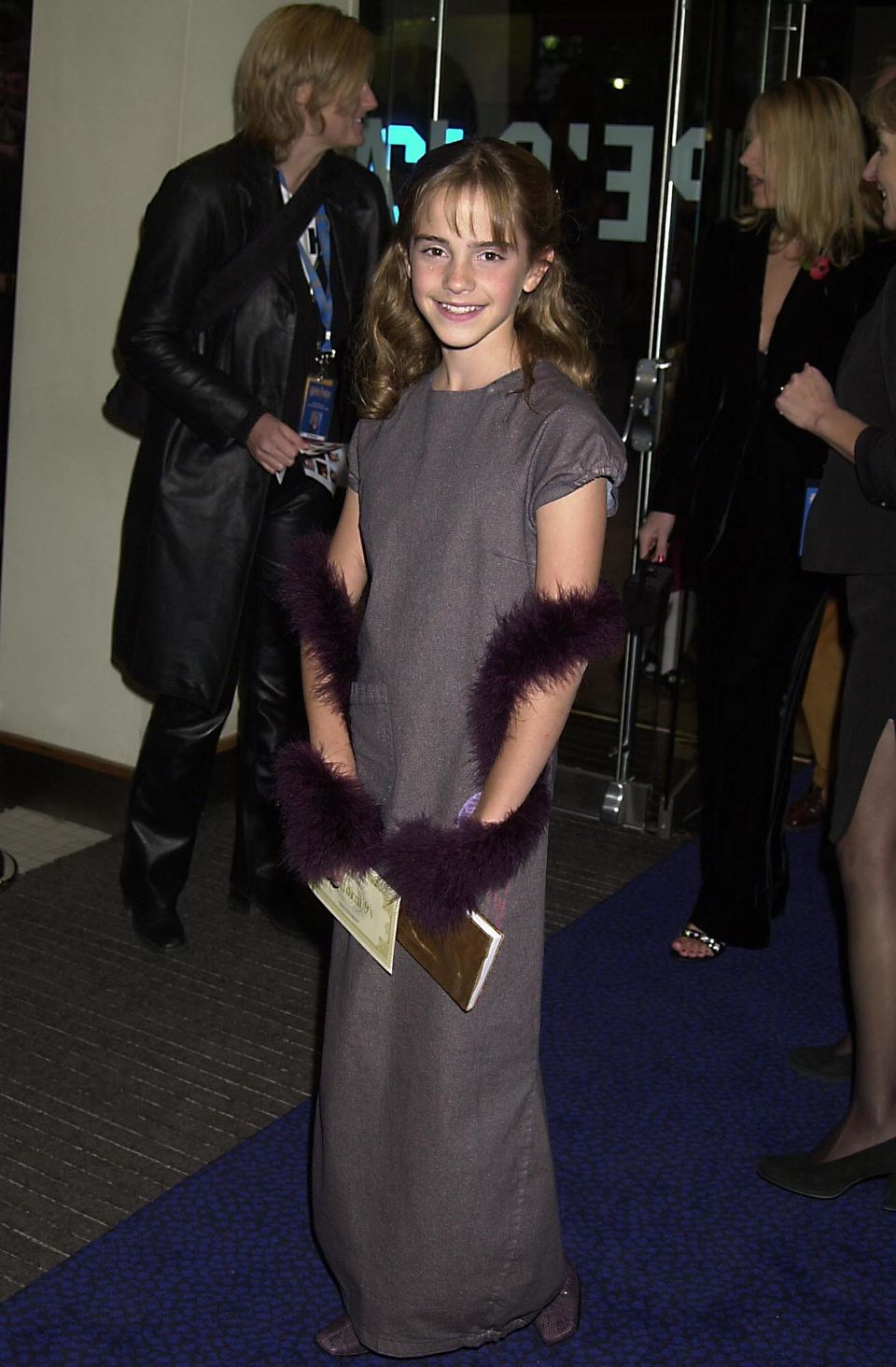 """Back when the first installment of """"Harry Potter"""" was released, Emma Watson was just a kid with a penchant for feathered boas"""