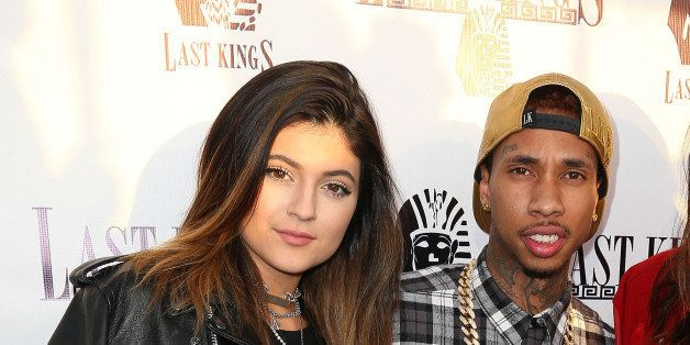 LOS ANGELES, CA - FEBRUARY 20: (L-R) Television personality Kylie Jenner, rapper Tyga, and television personality Kendall Jenner attend the exclusive press preview of Tyga's new store, Last Kings Flagship Store, on February 20, 2014 in Los Angeles, California. (Photo by Imeh Akpanudosen/Getty Images)