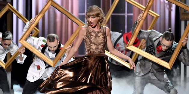 LOS ANGELES, CA - NOVEMBER 23:  Recording artist Taylor Swift performs onstage at the 2014 American Music Awards at Nokia The