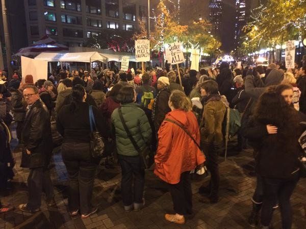 In this photo from Twitter user lilhalfpint79, people protest in Seattle on Mon. Nov, 24, 2014.