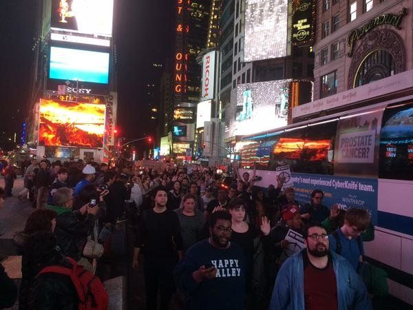 In this photo from Twitter user michaeljtabb, people protest in New York City. on Mon. Nov, 24, 2014.