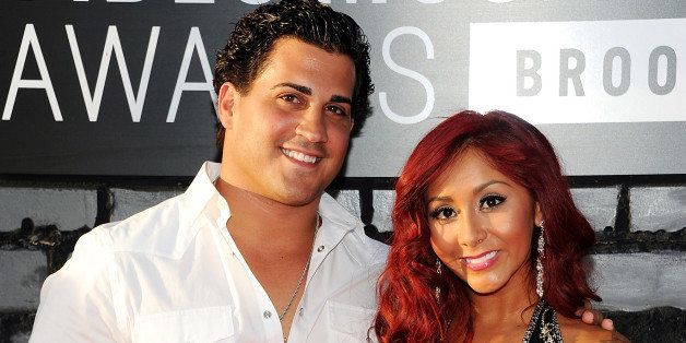 "CORRECTS BABY WEIGHT - FILE - In this Aug. 25, 2013 file photo, Nicole ""Snooki"" Polizzi, right, and Jionni LaValle  arrive at"