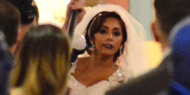 EAST HANOVER, NJ - NOVEMBER 29:  Nicole 'Snooki' Polizzi attends her wedding to Jionni LaValle at Saint Rose of Lima Church o