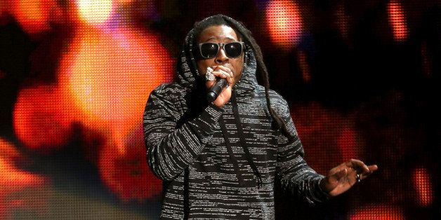 Lil Wayne performs at the 42nd annual American Music Awards at Nokia Theatre L.A. Live on Sunday, Nov. 23, 2014, in Los Angel