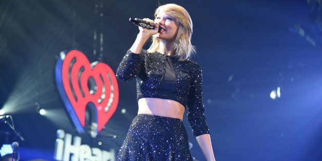 LOS ANGELES, CA - DECEMBER 05:  Singer Taylor Swift performs onstage during KIIS FM's Jingle Ball 2014 powered by LINE at Sta