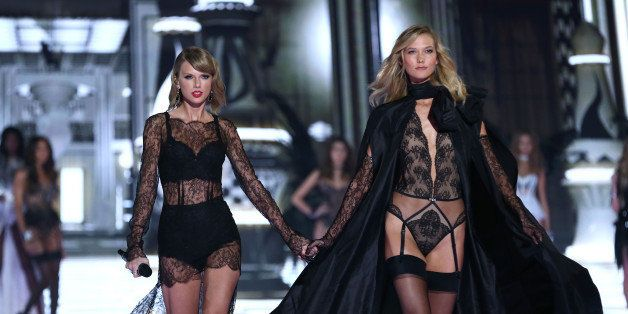 LONDON, ENGLAND - DECEMBER 02:  Taylor Swift and Karlie Kloss walk the runway at the annual Victoria's Secret fashion show at