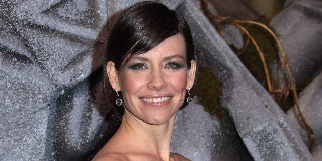 Actress Evangeline Lilly poses for photographers upon arrival at the World premiere of the film The Hobbit, The Battle of the