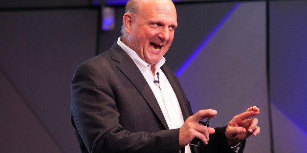 Steve Ballmer, the outgoing chief executive officer of Microsoft Corp., gestures as he speaks during a news conference in the