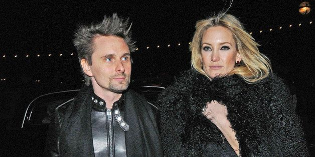 LONDON, UNITED KINGDOM - FEBRUARY 21: Matt Bellamy from Muse and Kate Hudson are seen on February 21, 2013 in London, United