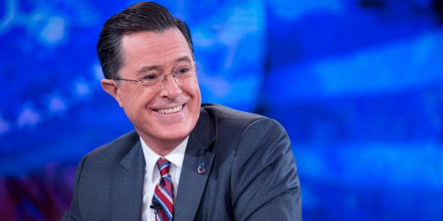 Television personality Stephen Colbert smiles while taping the 'The Colbert Report' with U.S. President Barack Obama, not pic