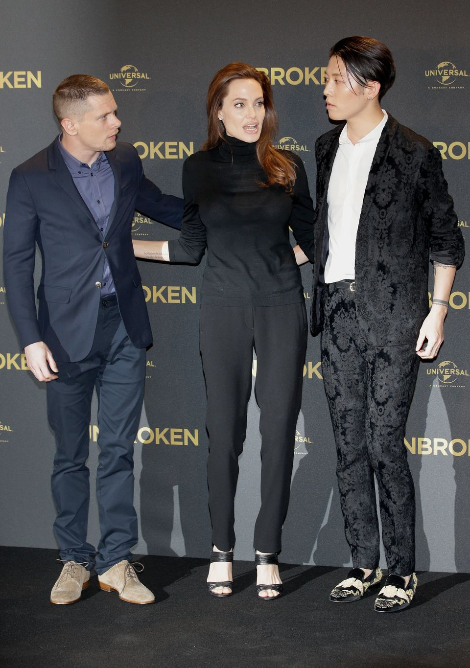 US director Angelina Jolie, center, and the actors Jack O'Connell, left, and Miyavi, right, pose for the photographers during